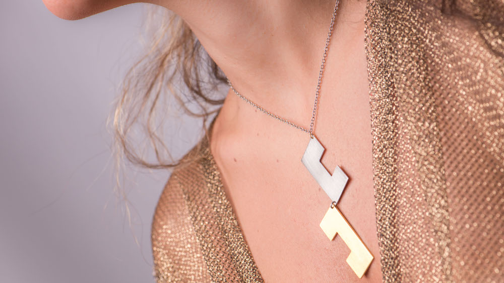 Silver And Gold Pieces of Puzzle Necklace